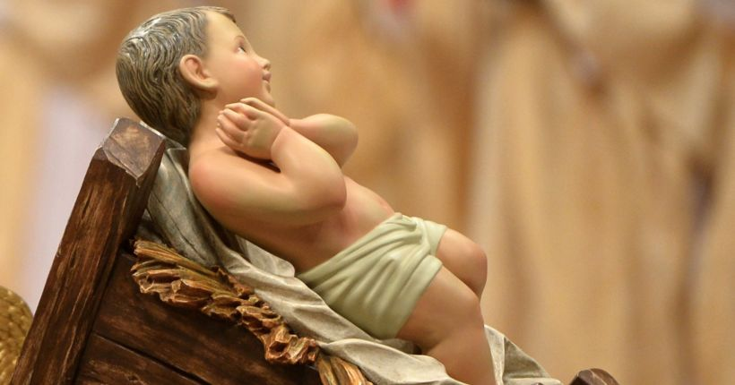 Topless protester tries to grab baby Jesus figure from Vatican nativity scene