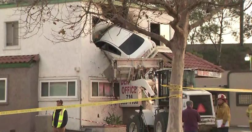 2 injured after car goes airborne, crashes into 2nd floor of Santa Ana building; speed, narcotics appear to be factors