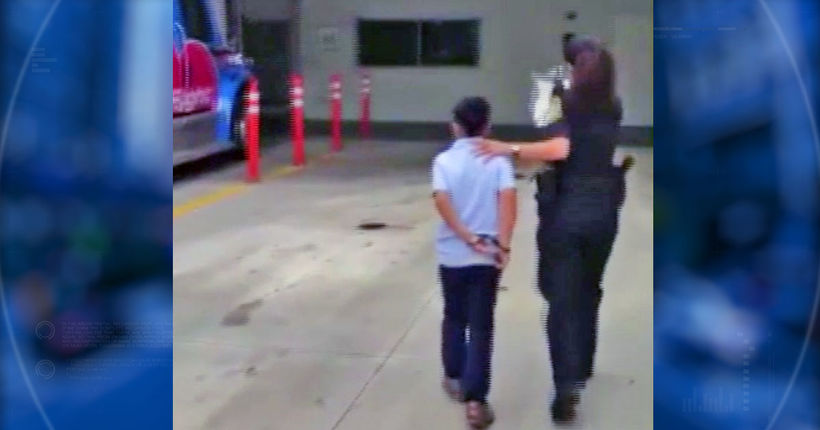 Video shows 7-year-old boy in handcuffs; boy is accused of attacking teacher at school