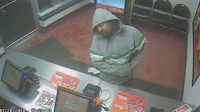Caught on camera: Suspect sought in robbery of Little Caesars Pizza in Milwaukee