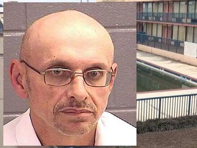 Burglar calls 911 to report dead man found inside motel wall