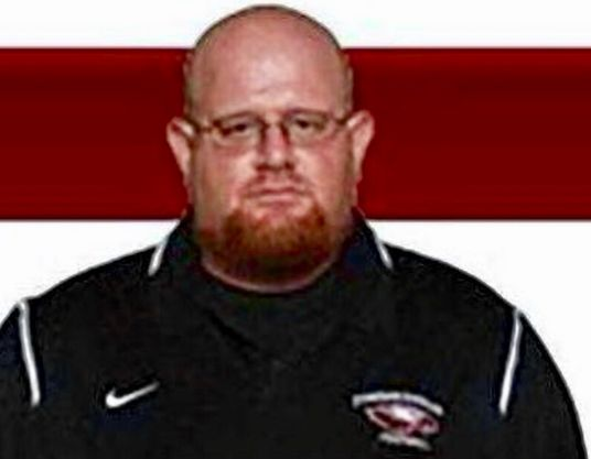 Coach dies after shielding students from gunfire in Parkland school shooting