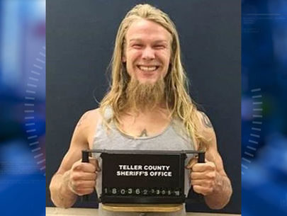 High-risk sex offender smiles in mug shot after being captured