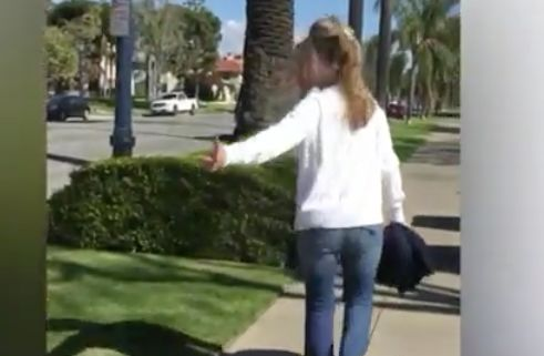 College professor IDed as woman in viral video telling Long Beach couple to 'go back to your home country'