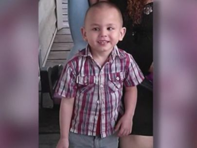 'He's with his dad:' Video shows mom of boy found buried being questioned