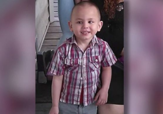 'He's with his dad:' Video shows mother of boy found buried being questioned by police