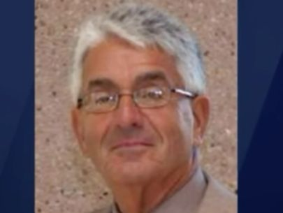 Retired superintendent charged with theft from charity