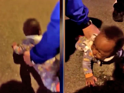 Mom arrested after video shows baby lying in middle of road