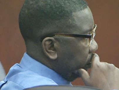 Man who posted photos online of dead wife, child on trial