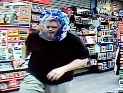 Man uses bottled water shrink-wrap case as mask in robbery