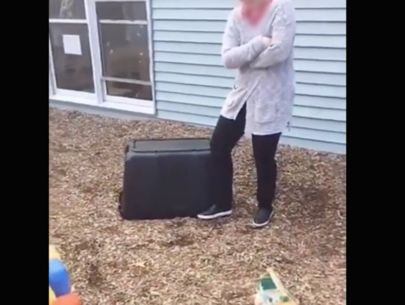 Video shows daycare workers laughing as kid is pinned under container