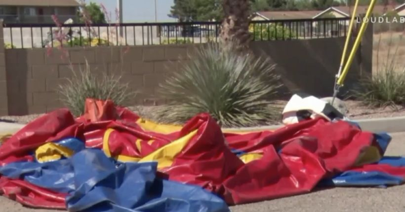 Bounce house carrying kid blown by winds onto highway