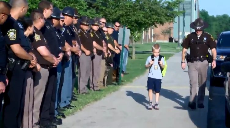 70 officers welcome son of fallen cop on his first day back at school