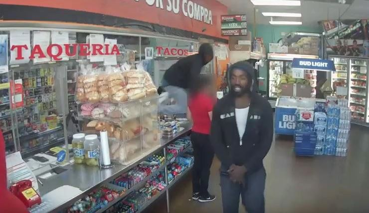 Surveillance video shows suspects accused in robbery of grocery store