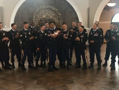 Newborn of fallen hero does photo shoot with fellow soldiers