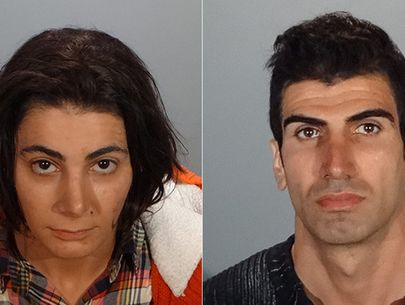 Brother and sister arrested after routine probation check reveals arsenal