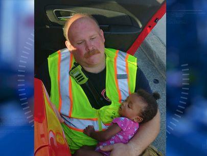 Photo of firefighter cradling girl after car wreck goes viral