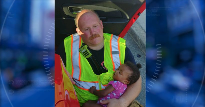 Photo of firefighter cradling little girl after car wreck goes viral