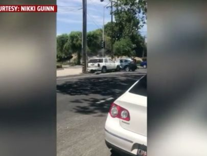 Video shows man repeatedly ramming, jumping on top of car