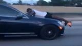 Florida video shows man riding on hood of car going 70 mph on I-95