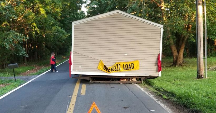 Police trying to figure out who left house in middle of road