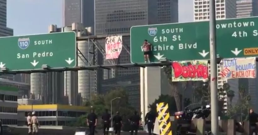 Man in underwear arrested after back-flipping off freeway sign in L.A.