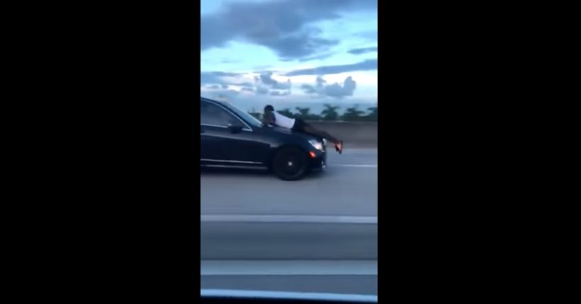 Florida woman who was filmed driving on highway with ex-boyfriend clinging to car's hood speaks out