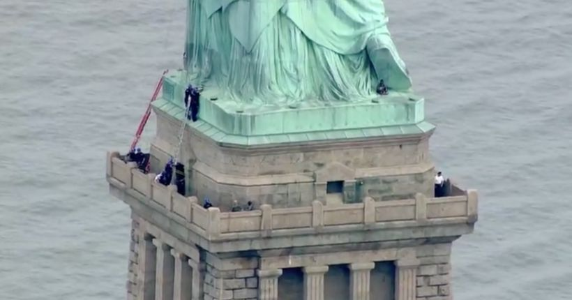 Woman in custody after climbing Statue of Liberty on July 4th, police say