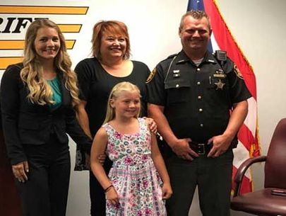Deputy honored for saving kid choking on candy