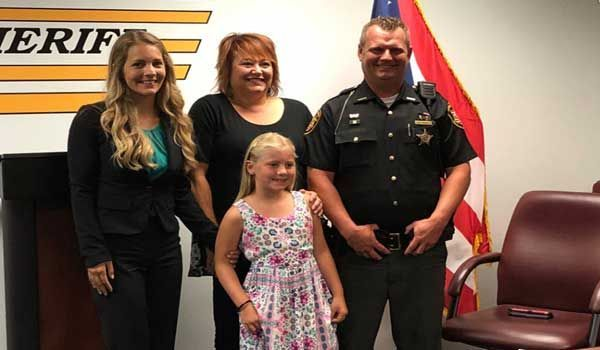 Deputy honored for saving 8-year-old choking on candy