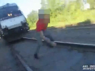 WATCH: Body-camera records police officer saving man from oncoming train