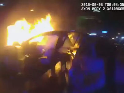 WATCH: Police body-cam captures officers rescue man from burning car