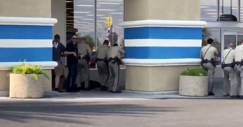 Security guard shot by police after firing gun at store manager, officers