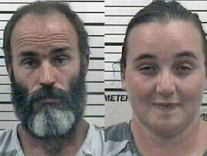 Parents accused of withholding food, showers from sons, sitting on them for…