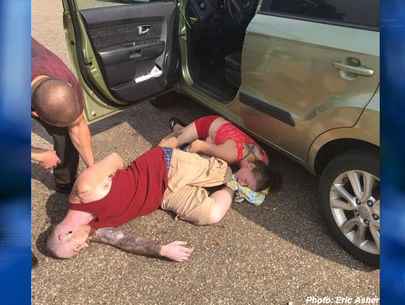 Pic shows couple passed out in heroin overdose with baby in car