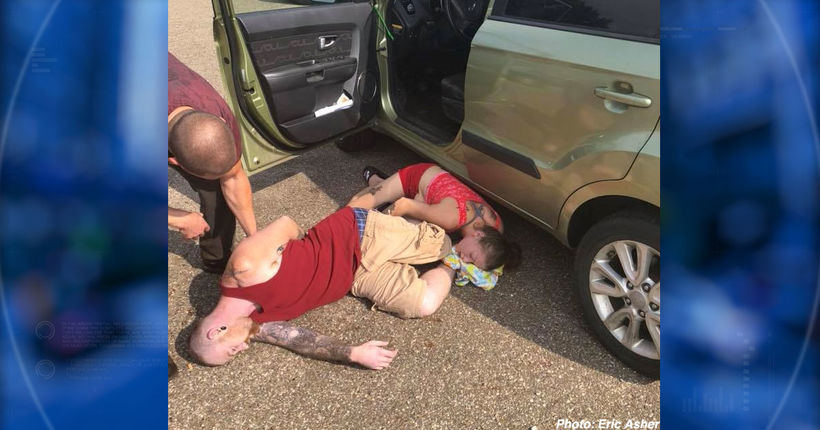 Picture shows couple passed out following reported heroin overdose with baby in car