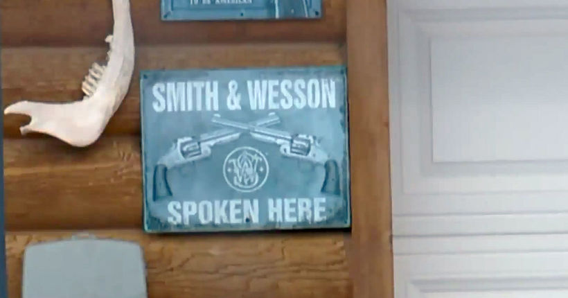 Burglar shot breaking into house with 'Smith & Wesson spoken here' sign outside, strips naked, confronts deputies