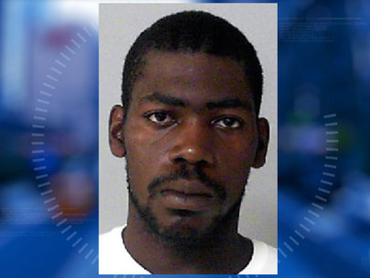 Man arrested after shooting at officers from riding lawnmower