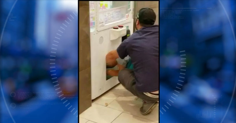 Police seek man who used tot to steal prizes from vending machine